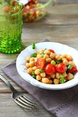 Salad with boiled chickpeas and tomatoes