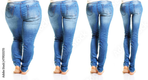 Leinwanddruck Bild Woman in blue jeans isolated on white background