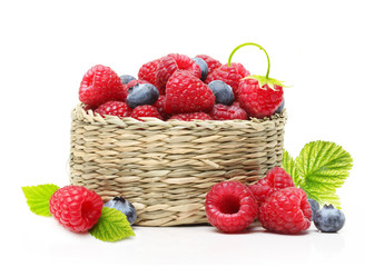 Raspberry and blueberry in basket