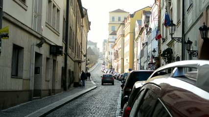 urban vintage street with cars and walking people