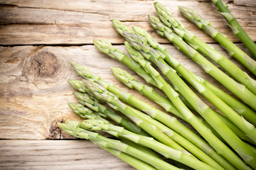 Asparagus on the wooden background.