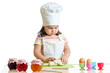 little baker kid girl in chef hat at kitchen