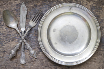 Old vintage cutlery and dishware abstract food background