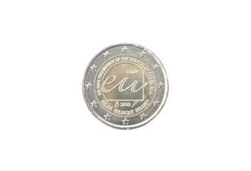 Commemorative 2 euro coin of Belgium minted in 2010 over white