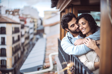 Romantic young couple at window