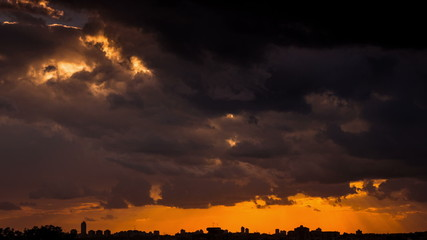 Time lapse of storm clouds over city silhouette - Dark Sky