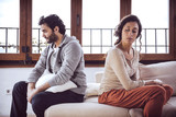 Couple not talking after a fight on the sofa in living room at h