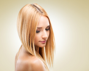 Beautiful blonde woman in profile, looking down