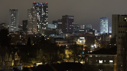 Birmingham, England city centre skyline at night - telephoto.
