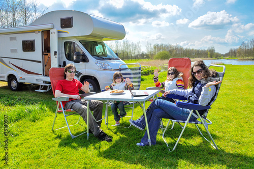 Family vacation, RV (camper) travel with kids in motorhome - 79140907