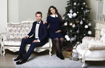 Beautiful stylish couple, husband and wife sitting