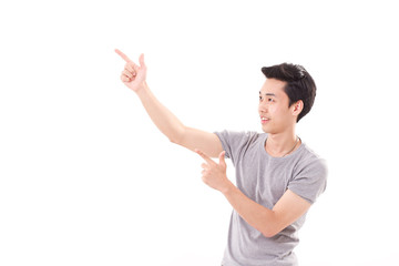 happy, smiling, exited man pointing finger up, white isolated ba