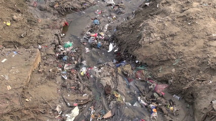 polluted open sewerage channel on Ganges coast in Varanasi