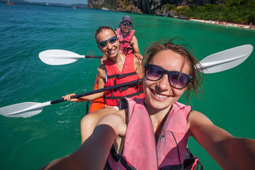 Caucasian woman is kayaking in sea at Thailand