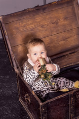 small European girl eats basket, sitting in a box
