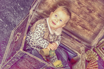 a beautiful American girl sitting in a wooden chest,