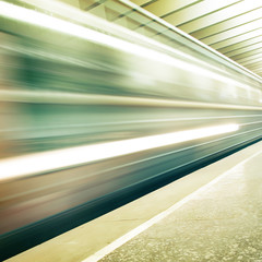 Image of subway train in motion blur.