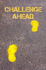 Yellow footsteps on sidewalk towards Challenge Ahead message