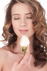 Close-up of beautiful girl with white rose flower