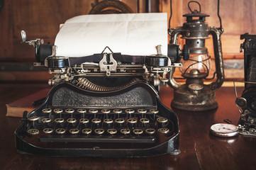 vintage photography still life with typewriter, folding camera,