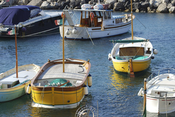 fishing boats in a small harbor of the Amalfi Coast Italy