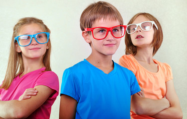 group of cute kids with eyeglasses