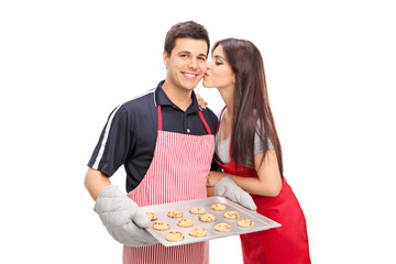 Young couple baking cookies together