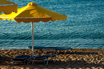 yellow parasol on the beach near the sea