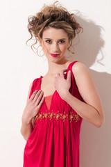 Close-up of beautiful girl with red vogue maekeup