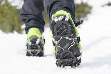hiking boots with equipment for ice
