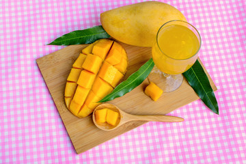 Yellow mango on wooden table