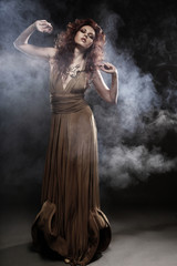 young woman in beige long dress