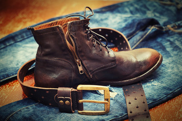 Fashion trend - jeans, leather shoes, leather belt with buckle