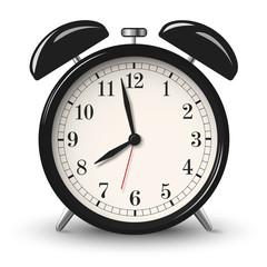 Black retro alarm clock isolated on white background