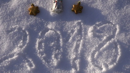 2018 new year written on snow and  vintage Christmas toys