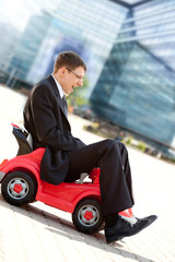 Businessman and Toy Red Car