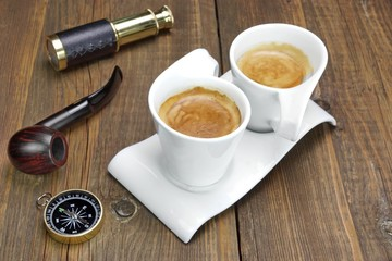Spyglass, Compass, Smoking Pipe and Two White Espresso Coffee Cu