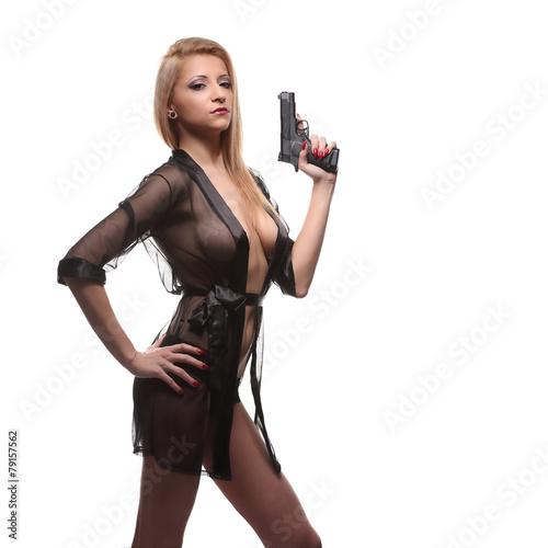 Leinwanddruck Bild elegant fashionable woman with a gun in hands