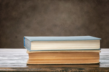 Books on brown grungy background