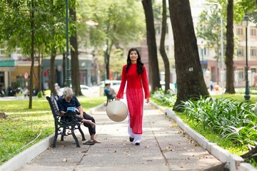 Elegant young Vietnamese woman in a park