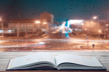 Reading a book on a rainy evening