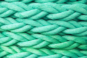 Green nautical rope, close-up background texture