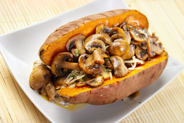 Oven cooked sweet potato , filled with mushroom