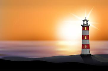 Lighthouse on the seashore at sunset