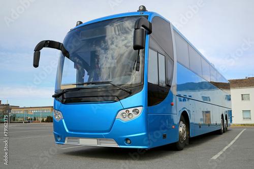 Leinwanddruck Bild Blue Bus Waits for Passengers