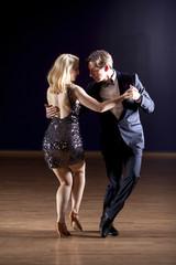 Tango dancers with dramatic lighting