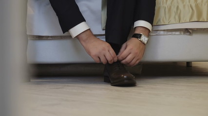 Business man dressing up with classic, elegant shoes. Groom