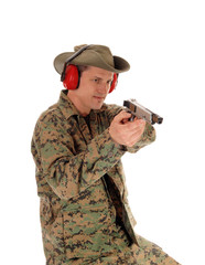Soldier pointing a pistol.