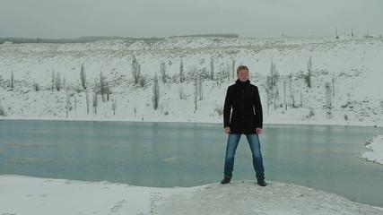 Young Man Singing At Winter Lake