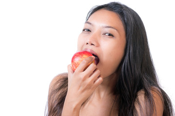 young woman eat red apple